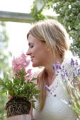 Woman smelling Astilbe