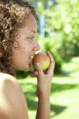 Girl eating pear