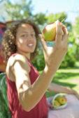 Girl holding pear