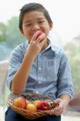 Boy eating nectarine