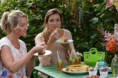 Ladies eating orange cake