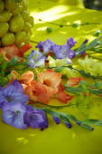 Gladioli on yellow table