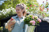 Lady holding hydrangea and chicken