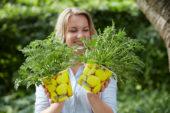 Lady holding pelargonium plants