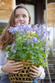 Young lady with Aquilegia