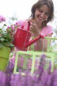 Woman watering seedlings