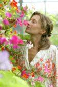 Woman smelling sweet peas