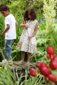 Children fishing in garden