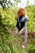 Woman trimming ornamental grass