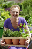 Woman gardening with herbs