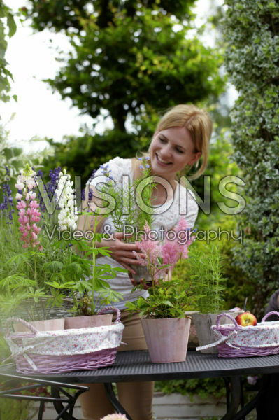 Woman holding Astilbe