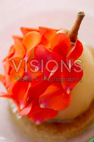 Poached pear with rose petals