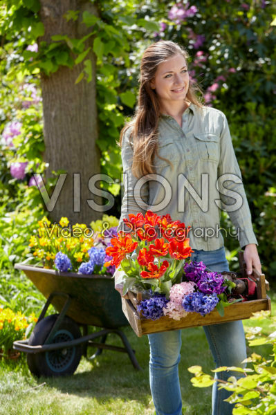 Young lady with spring flowers