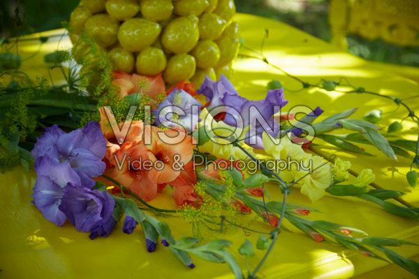 Gladioli on yellow table