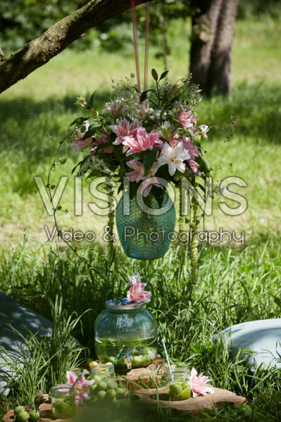 Hanging vase with lilies