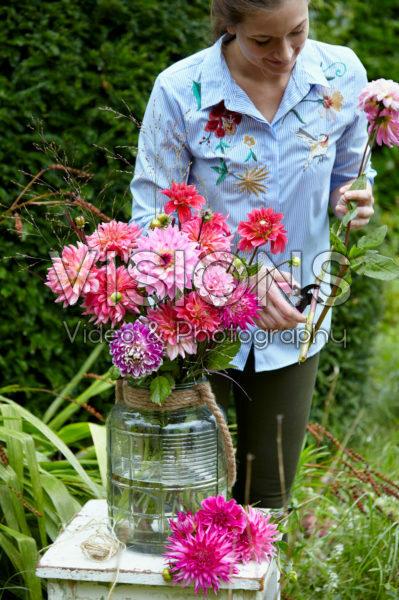 Lady making Dahlia bouquet