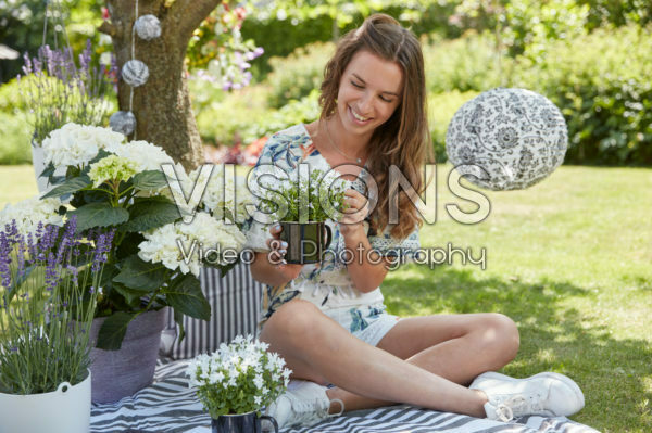 Lady relaxing under tree