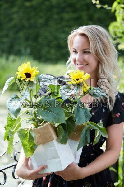 Lady holding sunflowers