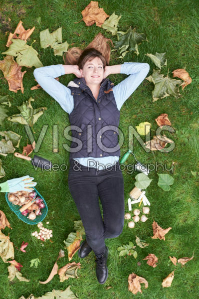young lady lying in the grass