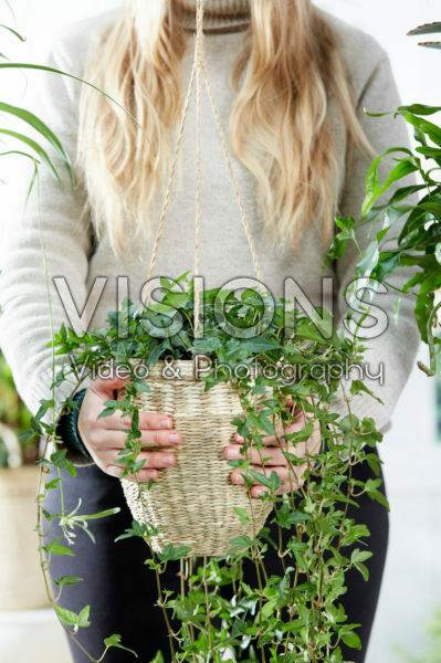 Lady holding hanging basket