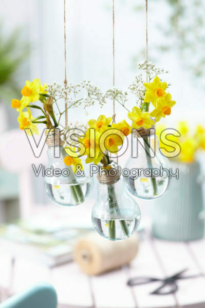 Spring flowers in light bulb