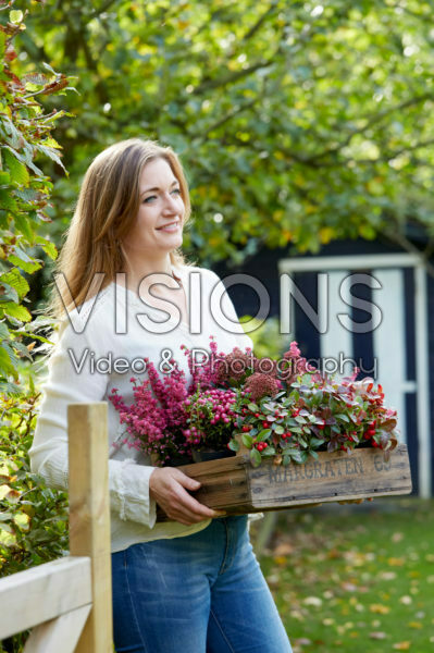 Young lady with autumn container