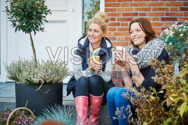 Ladies having a cuppa in autumn garden
