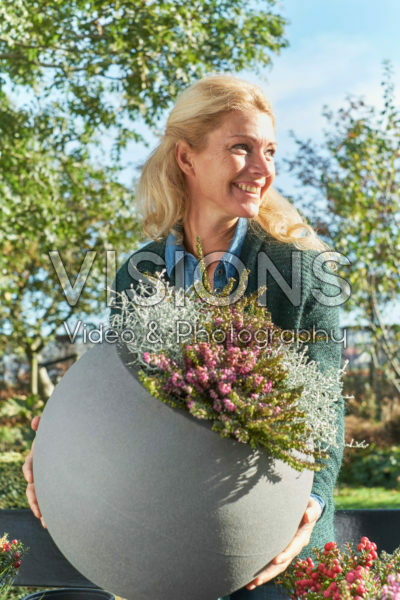 Lady with autumn container