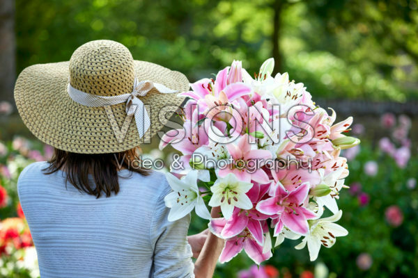 Lady holding bunch of lilies